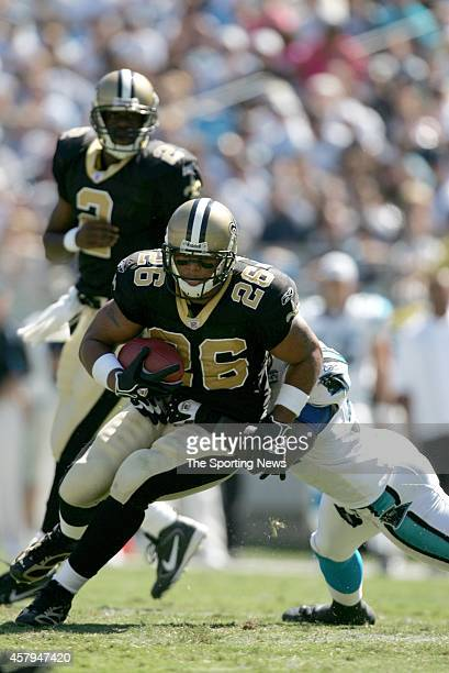 Deuce McAllister of the New Orleans Saints gets tackled during a game against the Carolina Panthers on September 11 2005 at the Bank of America...