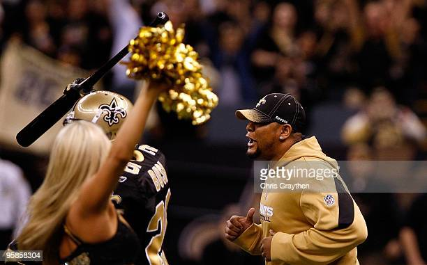 Deuce McAllister of the New Orleans Saints runs onto the field behind Reggie Bush during pregame festivities against the Arizona Cardinals during the...