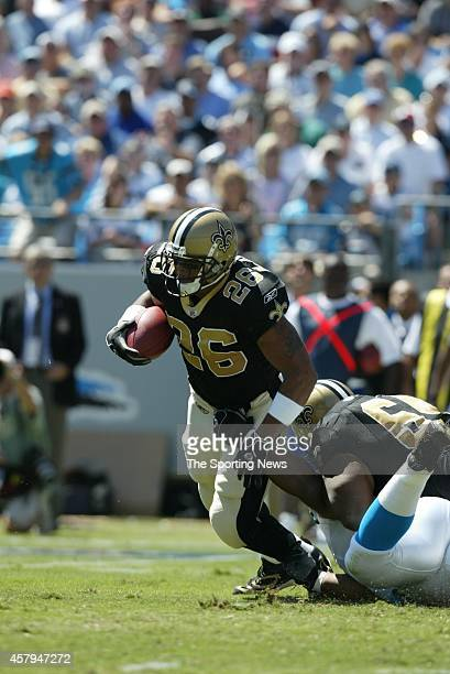 Deuce McAllister of the New Orleans Saints runs through the tackle during a game against the Carolina Panthers on September 11 2005 at the Bank of...