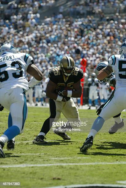 Deuce McAllister of the New Orleans Saints runs with the ball during a game against the Carolina Panthers on September 11 2005 at the Bank of America...