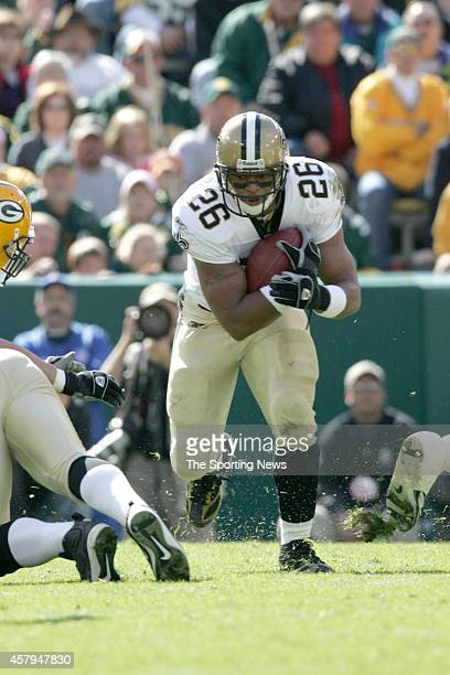 Deuce McAllister of the New Orleans Saints runs with the ball during a game against the Green Bay Packers on October 9 2005 at Lambeau Field Stadium...