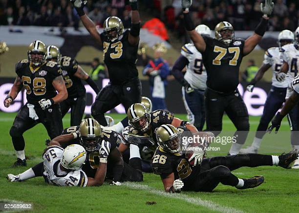 Deuce McAllister of the New Orleans Saints scores a touchdown against the San Diego Chargers at Wembley Stadium during the NFL International Series...