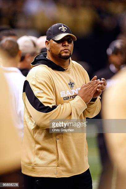 Deuce McAllister of the New Orleans Saints stands on the field against the Arizona Cardinals during the NFC Divisional Playoff Game at Louisana...