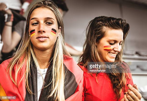 deutsch and spanish supporter at the soccer stadium