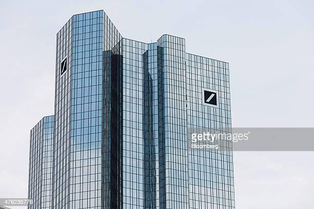 Deutsche Bank logos sit on display on the twin tower skyscraper headquarters of Deutsche Bank AG in Frankfurt Germany on Saturday June 6 2015...