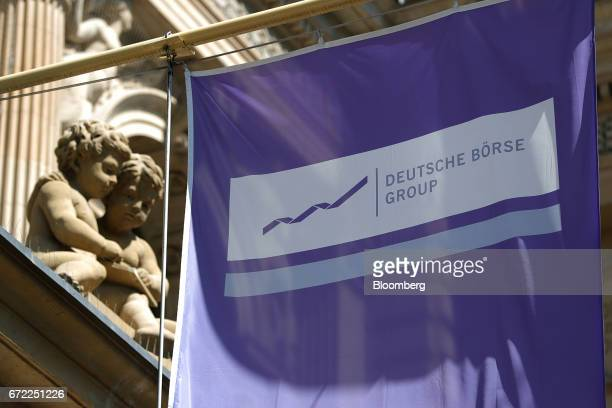 A Deutsche Boerse Group banner hangs outside the Frankfurt Stock Exchange in Frankfurt Germany on Monday April 24 2017 Frances bonds jumped with the...