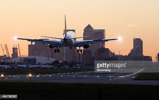 A Deutsche Lufthansa AG aircraft lands at London City Airport near to the Canary Wharf business financial and shopping district in London UK on...