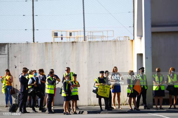 Deutsche Lufthansa AG employees and union members gather during protest outside the Lufthansa Aviation Center at Frankfurt Airport in Frankfurt...