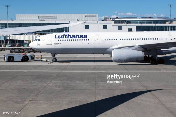 Deutsche Lufthansa AG plane sits on the tarmac at Vancouver International Airport in Vancouver, British Columbia, Canada, on Tuesday, Aug. 4, 2020....