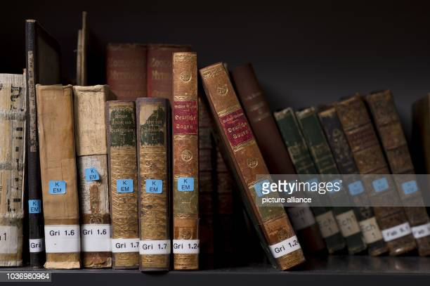 'Deutsche Sagen' from 18161818 from the Grimm Brothers sits with other books on a shelf in the Cultural Science Center of the University of...