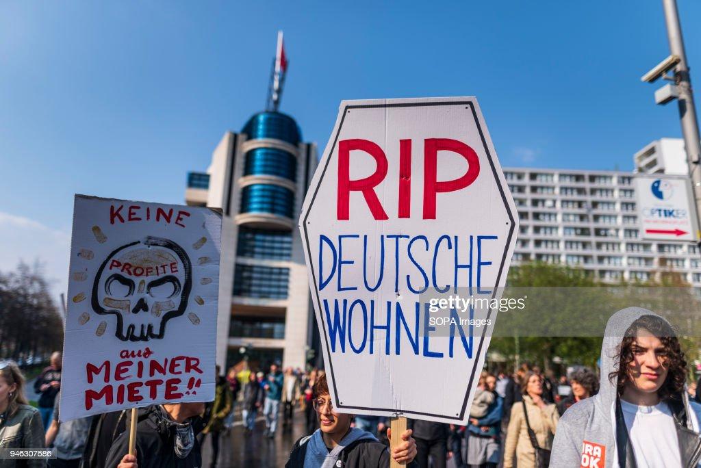 Deutsche Wohnen Com rip deutsche wohnen is written on a sign of a demonstrant