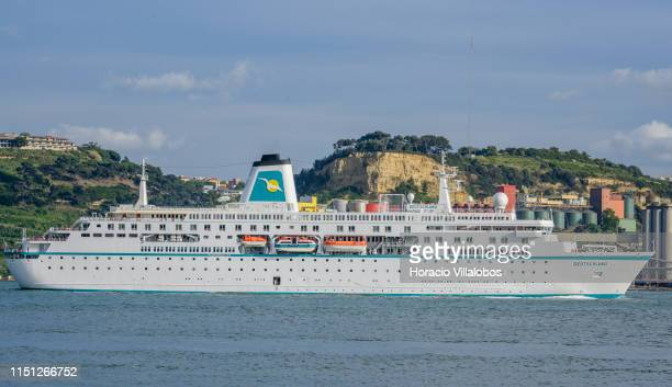 Deutschland a cruise ship registered in Nassau Bahamas sails on the Tagus River while leaving harbor on her way to Leixoes on May 23 2019 in Lisbon...