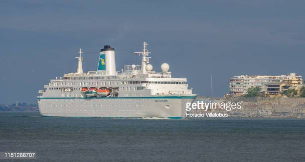 Deutschland a cruise ship registered in Nassau Bahamas sails the Tagus River towards the 25 de Abril Bridge while leaving harbor on her way to...