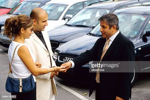 A turkish couple at AUDI Ali Haydar Berkpinar a turkish salesman handing over the key