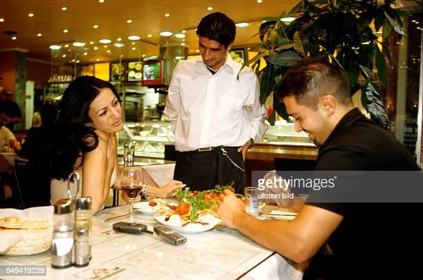 A turkish couple eating dinner in the bar restaurant Kaplan