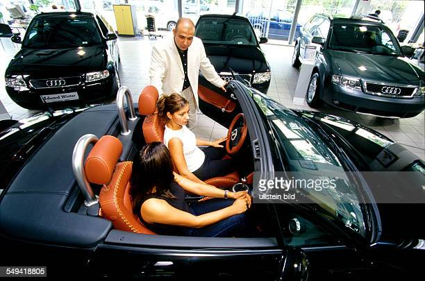 VW/Audi Two turkish women and a friend in the carcentre Audi TT