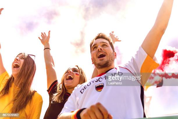 deutschland supporters at stadium during a football league - germany stock pictures, royalty-free photos & images