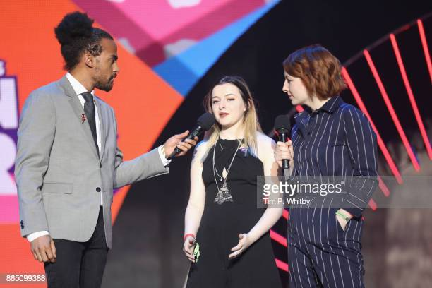 Dev Griffin Teen Hero award winner Charlotte and Alice Levine appear on stage during the BBC Radio 1 Teen Awards 2017 at Wembley Arena on October 22...
