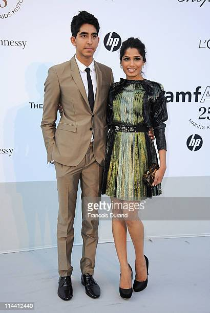 Dev Patel and Freida Pinto attends amfAR's Cinema Against AIDS Gala during the 64th Annual Cannes Film Festival at Hotel Du Cap on May 19 2011 in...