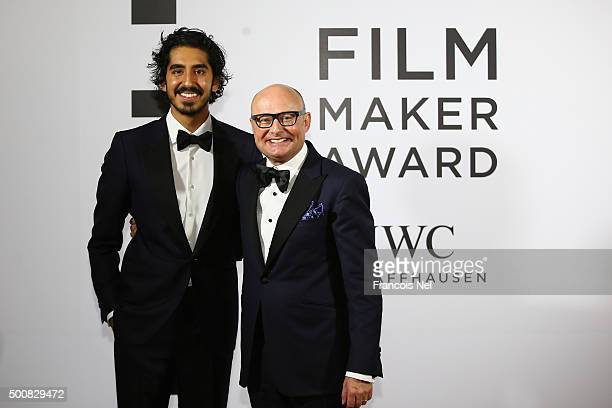 Dev Patel and IWC CEO Georges Kern pose during the IWC Filmmaker Award Night 2015 at The One Only Royal Mirage on December 10 2015 in Dubai United...