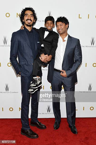 Dev Patel Sunny Pawar and Saroo Brierley attend the Lion premiere at Museum of Modern Art on November 16 2016 in New York City