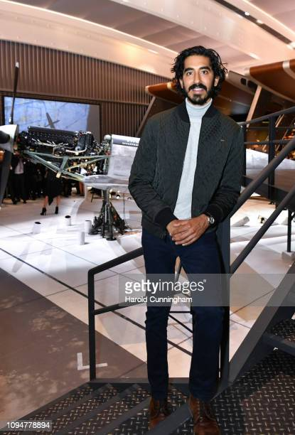 Dev Patel visits the IWC booth during the Maison's launch of its new Pilot's Watches at the Salon International de la Haute Horlogerie on January 15,...