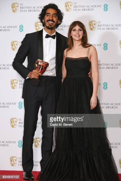 "Dev Patel, winner of the Supporting Actor award for ""Lion"", and presenter Felicity Jones pose in the winners room at the 70th EE British Academy Film..."