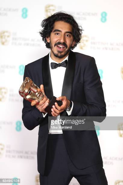 Dev Patel winner of the Supporting Actor award for 'Lion' poses in the winners room at the 70th EE British Academy Film Awards at Royal Albert Hall...