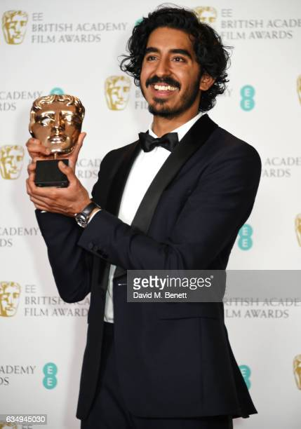 Dev Patel winner of the Supporting Actor award for Lion poses in the winners room at the 70th EE British Academy Film Awards at Royal Albert Hall on...