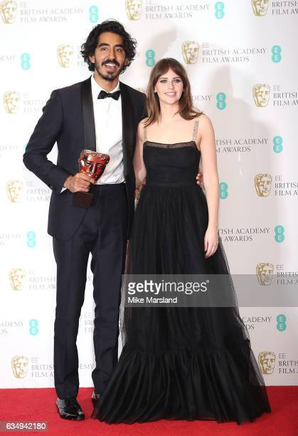 Dev Patel winner of the Supporting Actor award for 'Lion' poses with Felicity Jones in the winners room at the 70th EE British Academy Film Awards at...