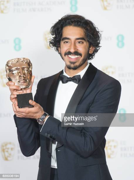 Dev Patel winner of the Supporting Actor award poses in the winners room at the 70th EE British Academy Film Awards at Royal Albert Hall on February...