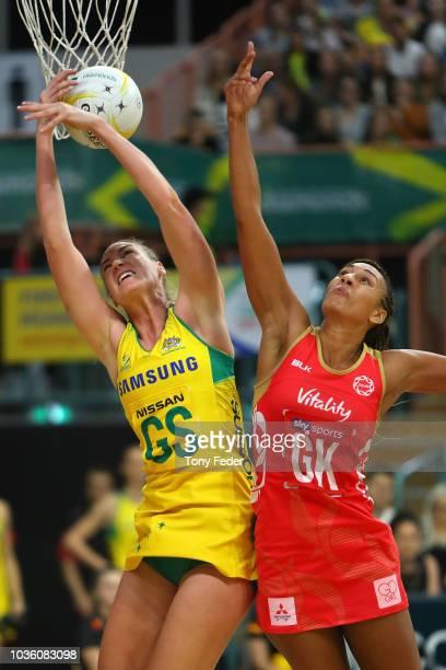 Deva Mentor of England tries to block Caitlin Bassett of the Diamonds during the Quad Series International Netball test match between the Australian...