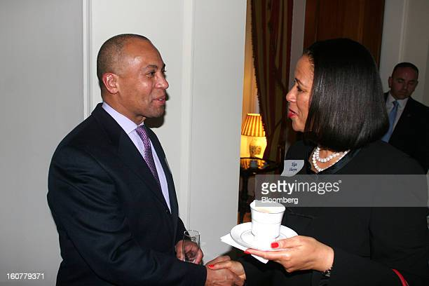 Deval Patrick Democratic governor of Massachusetts and Elga Sharpe chief of protocol for the mayor of Los Angeles converse at the residence of...
