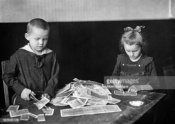 Devaluation of the Mark Children playing with banknotes which have no more value because of the inflation Weimar Republic circa 1919