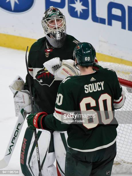 Devan Dubnyk and Carson Soucy of the Minnesota Wild celebrate defeating the Edmonton Oilers 3-0 after the game on April 2, 2018 at Xcel Energy Center...