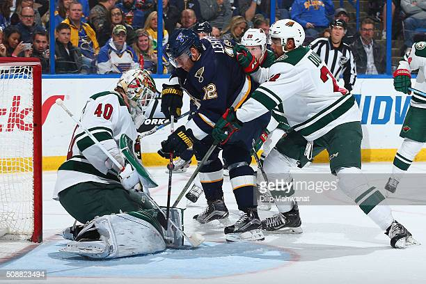 Devan Dubnyk and Matt Dumba defend the goal against Jori Lehtera of the St. Louis Blues at the Scottrade Center on February 6, 2016 in St. Louis,...