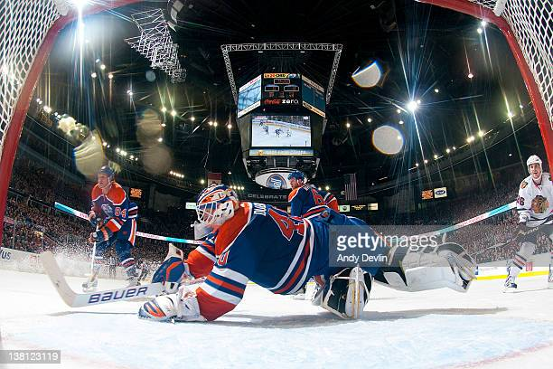 Devan Dubnyk of the Edmonton Oilers dives crosscrease to make a save against the Chicago Blackhawks at Rexall Place on February 2 2012 in Edmonton...