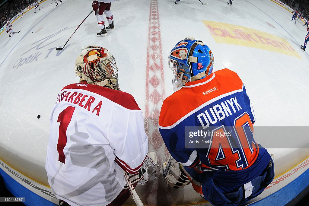 Devan Dubnyk #40 of the Edmonton Oilers exchanges words with Jason LaBarbera #1 of the Phoenix Coyotes prior to a game on February 23, 2013 at Rexall Place in Edmonton, Alberta, Canada.