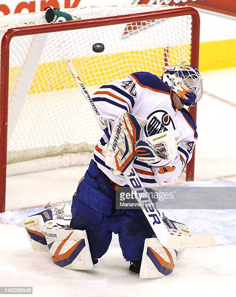 Devan Dubnyk of the Edmonton Oilers gets the puck deflected off him during a shot on goal in a game against the Winnipeg Jets in NHL action at the...
