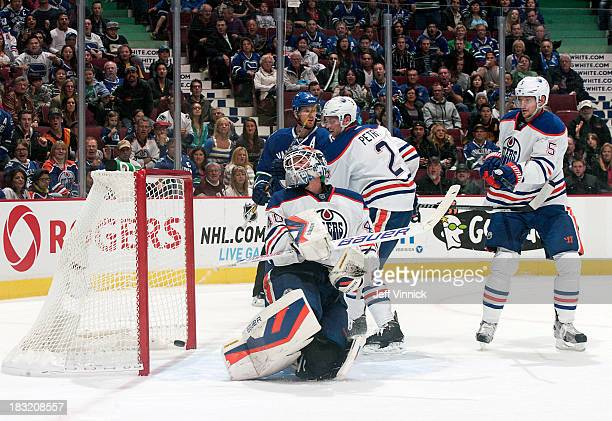 Devan Dubnyk of the Edmonton Oilers looks back as the puck crosses the line for a goal by the Vancouver Canucks during their NHL game at Rogers Arena...