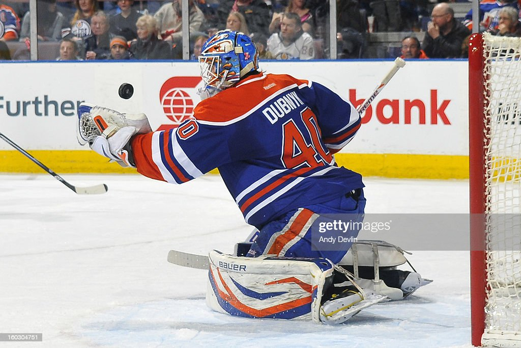 Devan Dubnyk #40 of the Edmonton Oilers makes a save in a game against the Colorado Avalanche at Rexall Place on January 28, 2013 in Edmonton, Alberta, Canada.