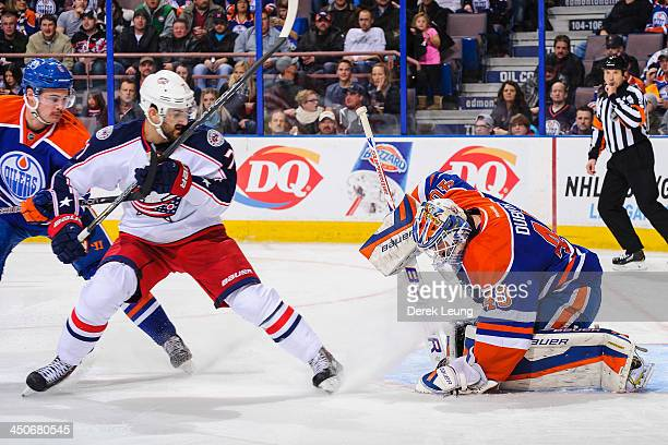 Devan Dubnyk of the Edmonton Oilers makes a save on the shot of Nick Foligno of the Columbus Blue Jackets during an NHL game at Rexall Place on...