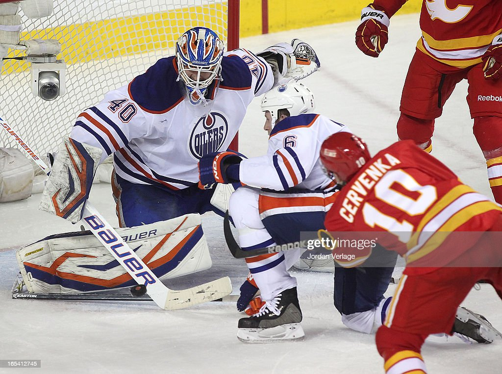 Devan Dubnyk #40 of the Edmonton Oilers stops a shot by Roman Cervenka #10 of the Calgary Flames at Scotiabank Saddledome on April 3, 2013 in Calgary, Alberta, Canada.