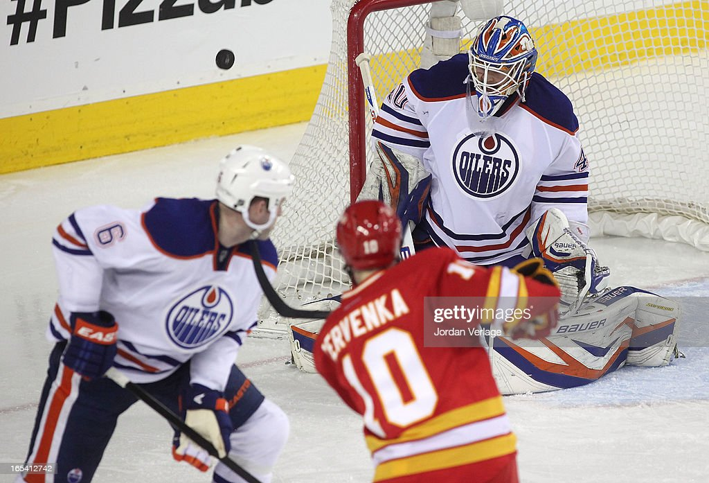 Devan Dubnyk #40 of the Edmonton Oilers watches as a shot by Roman Cervenka #10 of the Calgary Flames sails wide of the net at Scotiabank Saddledome on April 3, 2013 in Calgary, Alberta, Canada.