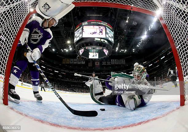 Devan Dubnyk of the Minnesota Wild and Duncan Keith of the Chicago Blackhawks watch the puck during the 2017 Honda NHL AllStar Game Semifinal at...