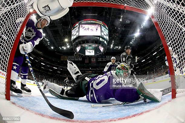 Devan Dubnyk of the Minnesota Wild attempts to make a save against Joe Pavelski of the San Jose Sharks during the 2017 Honda NHL AllStar Game...