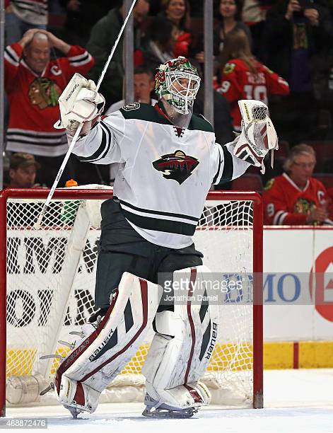 Devan Dubnyk of the Minnesota Wild celbrates a win over the Chicago Blackhawks at the United Center on April 7 2015 in Chicago Illinois The Wild...