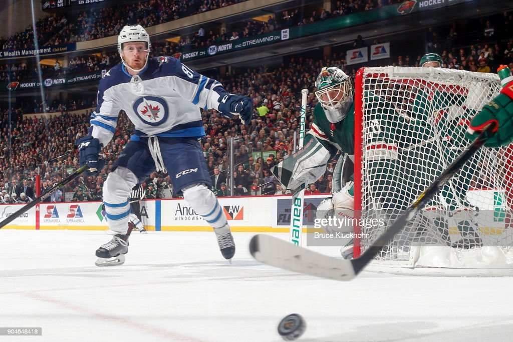 Devan Dubnyk #40 of the Minnesota Wild defends against Kyle Connor #81 of the Winnipeg Jets during the game at the Xcel Energy Center on January 13, 2018 in St. Paul, Minnesota.