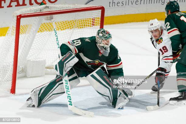Devan Dubnyk of the Minnesota Wild defends his goal against Jonathan Toews of the Chicago Blackhawks during the game at the Xcel Energy Center on...