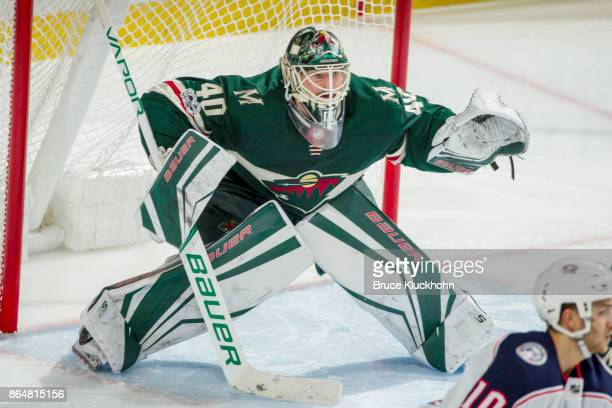 Devan Dubnyk of the Minnesota Wild defends his goal against the Columbus Blue Jackets during the game at the Xcel Energy Center on October 14 2017 in...